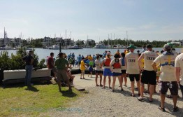 Preparing to get on the boat. Rowers are lined up in seat order.