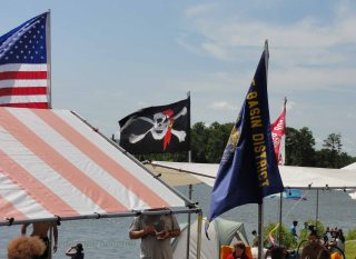 Flags flying in a reasonable breeze that made the heat tolerable.