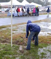 Young guy helps clear the tent pond.