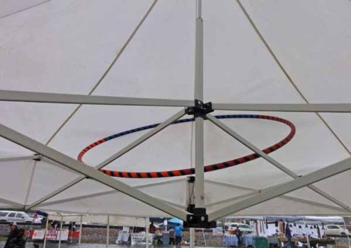 Putting a hoop to work inside the tent.