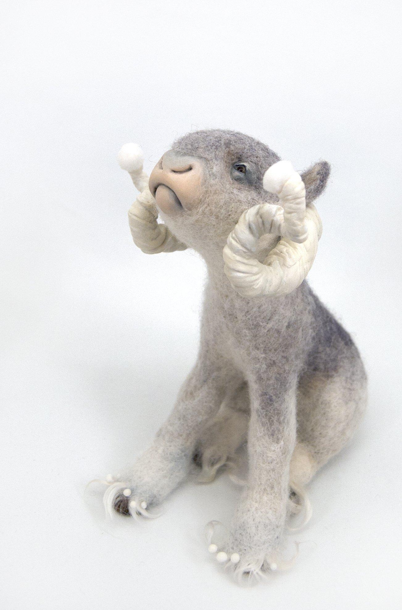 Needle felt snow creature with horns - Imaginary animal sculpture by Canadian artist Karina Kalvaitis