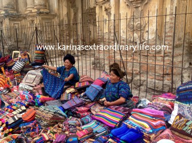 An article about street vendors in Antigua would not be complete without displaying Guatemalan women selling textiles in typical Mayan dress. A spectacular sight everyone should experience first hand. Antigua, Guatemala -- April Beresford