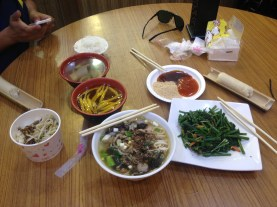 Trying cuisine prepared by local aborigines in Hualien. Our first time trying rice that was cooked in bamboo (far right), green ferns (also on the right), beef noodle soup, soup with yellow veggy that still remains unidentified, wild boar. We loved everything we tried and our entire meal was ordered and paid for by our gracious host in Hualien. Hualien, Taiwan - Karina Noriega