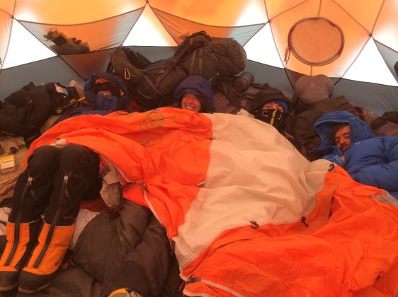 Climbers on Aconcagua via the 360 route huddling in tent for warmth