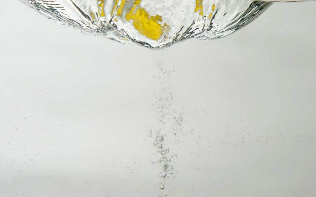 Lemon falling into water on grey Series 1