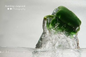 Green Pepper dropping into water 2