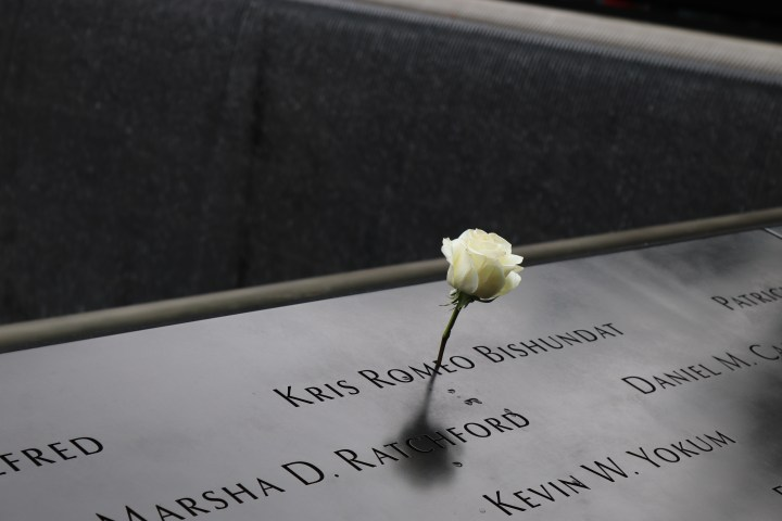 A white rose next to the name, Kris Romeo Bishundat, signifying that it was his birthday on the day of our visit to the World Trade Centre memorial.