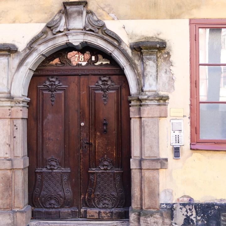 Decorated arched door in the Gamla Stan, Stockholm's Old Town.