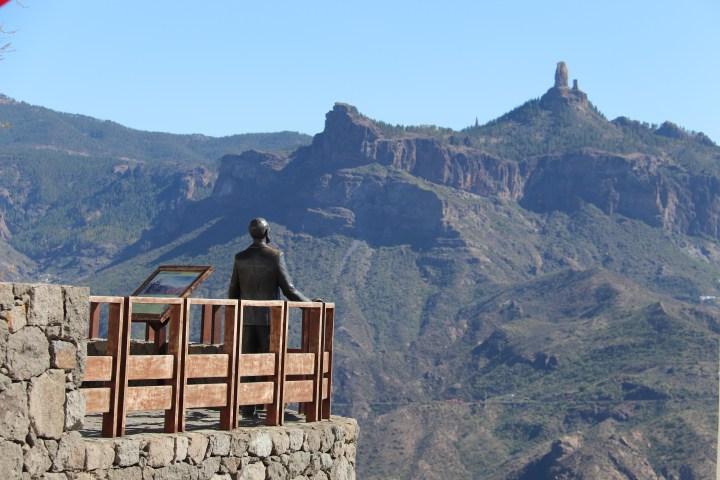 A bronze statue looks into the caldera at Artenara, Gran Canaria.
