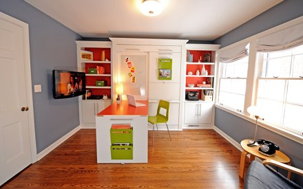 A space-saving fix for an underutilized guest room. It's a storage and shelving unit, desk and bed all in one!
