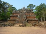 "This is a small temple called Phimeanakas, also part of the Angkor Thom complex. This style of temple is called ""mountain temple"" because of the tiers and pyramid shape. Most of the Angkor temples are considered mountain temples, I read."