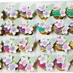 Rainbow High Tea Cupcakes With Sugar Flowers And Leaves