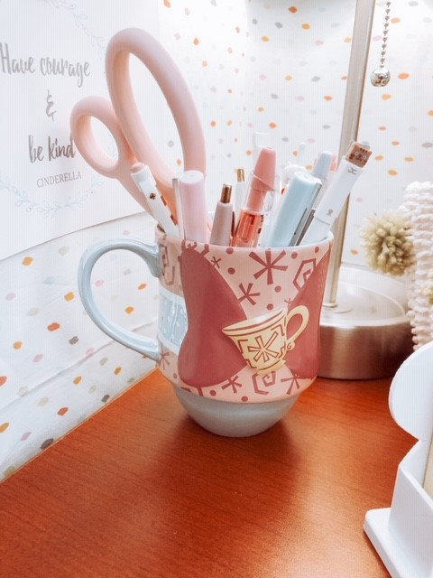 Disney mug to hold pens on desk