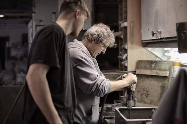 From legacy to DDD: https://www.pexels.com/photo/foreman-teaching-apprentice-working-with-tools-3846258/