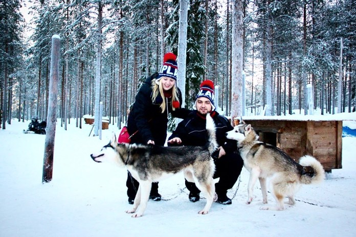 Playing with husky dogs in Rovaniemi