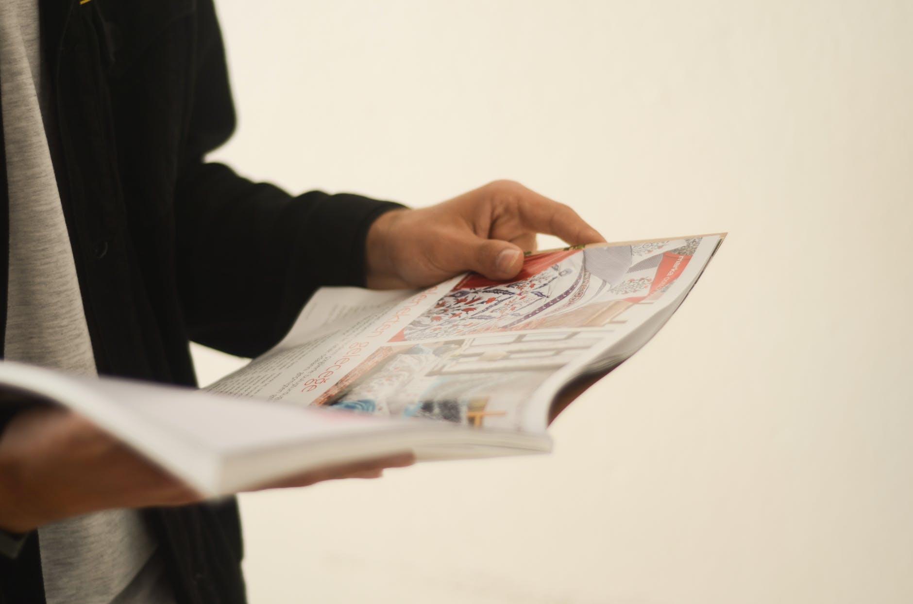 unknown person reading magazine
