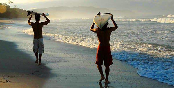florblanca-surfers-walking-down-beach-2