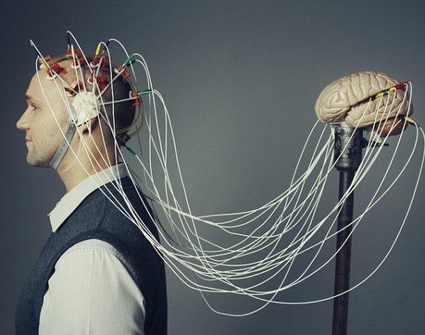 Man wearing brain hat --- Image by © Ben Hupfer/Corbis