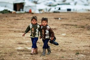 Two boys walking to their tent at a refugee camp in Syria. Image: Unicef