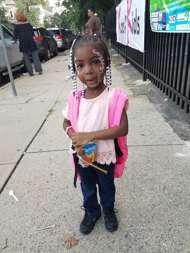 A young participant at the 2019 Kars4Kids backpack giveaway.