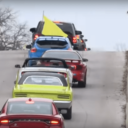 sports car funeral procession for Alec Ingram who died of cancer at age 14