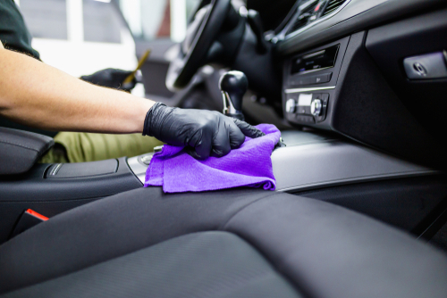 wiping down the interior of the car with a microfiber cloth prevents scratches from dust particles during cleaning