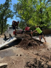 Tower empties dirt from back of pickup truck so it can be donated