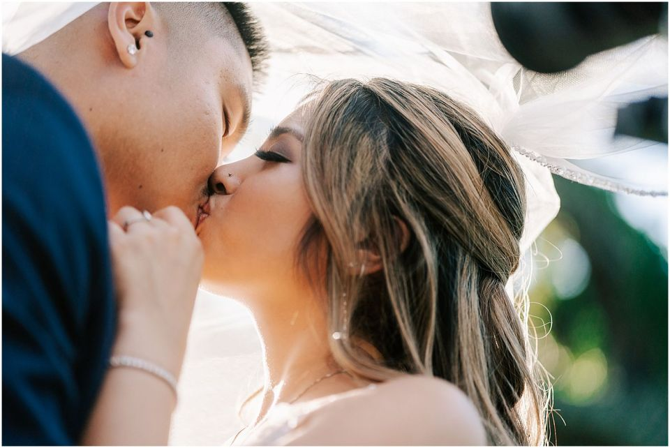 Couple shares kiss at this Woodcrest Country Club wedding