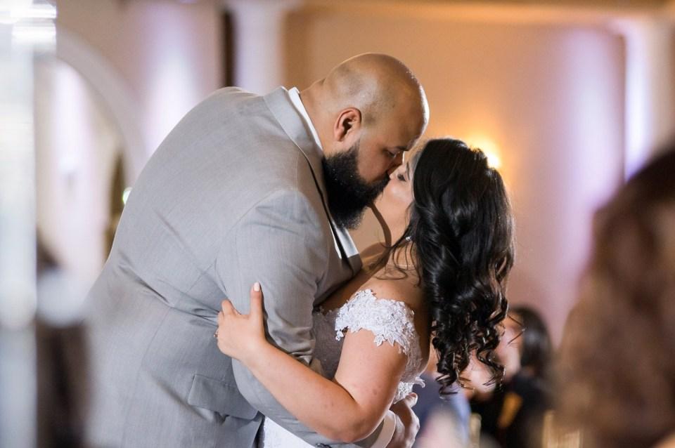 First kiss at the Versailles Ballroom Wedding venue