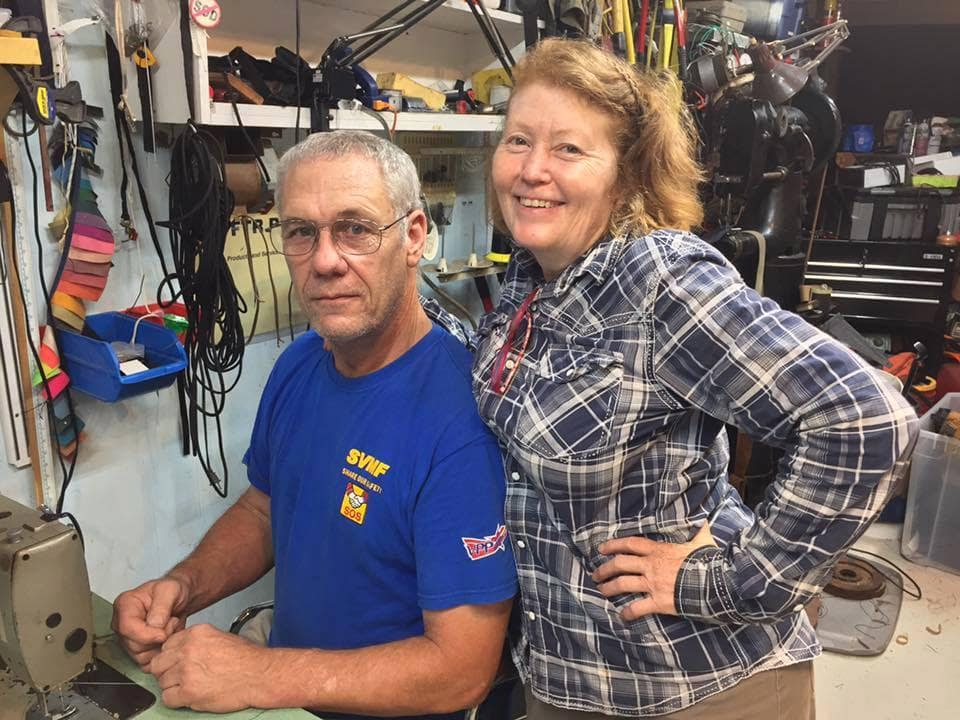 Bill Lee working in his rigging loft with his favorite boss - his wife of 38 years, Suni