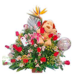 Lindo arreglo floral elaborado en cerámica decorada, viene con 18 rosas importadas, lilium perfumado, astromelias, ave de paraíso, fino follaje. Contiene globo metálico Nº 9, peluche en variados modelos y tarjeta de dedicatoria. Pueden adicionar chocolates y más, ingresando a la opción REGALOS en la parte superior de la Pág. web.