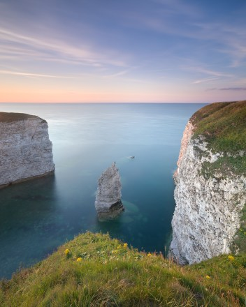 Chalk cliffs and clear blue sea at Breil Nook near the North Landing at Flamborough Head, Flamborough, East Yorkshire, UK
