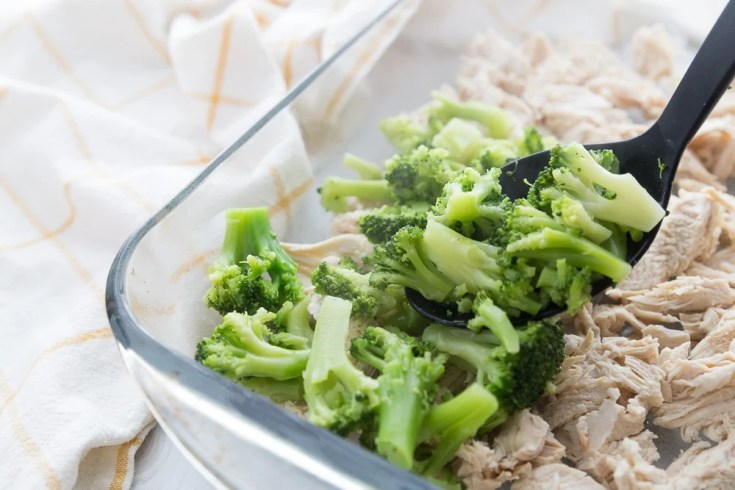 process picture of low carb chicken casserole with the chicken and broccoli in the baking dish