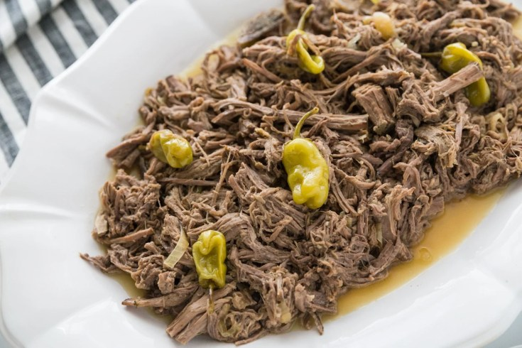 low carb pot roast slow cooker recipe plated on a white platter