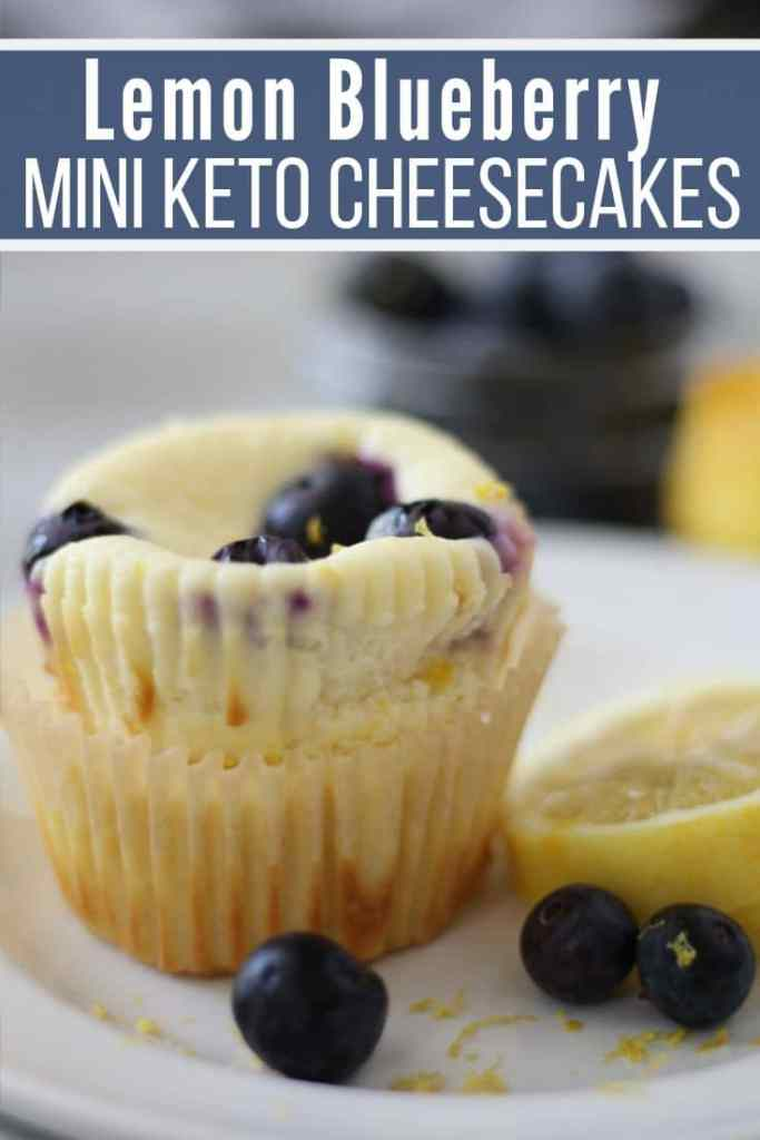 lemon blueberry mini keto cheesecakes plated with a slice of lemon and blueberries