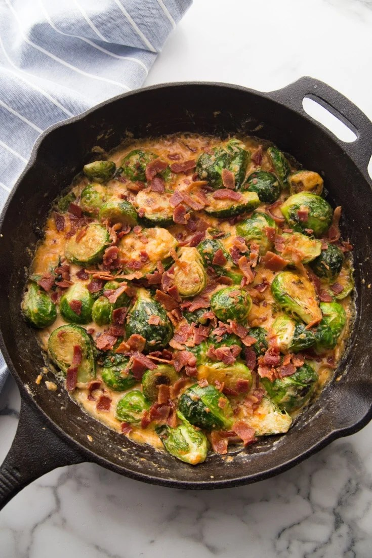 Keto Brussels sprouts out of the oven in a cast iron skillet