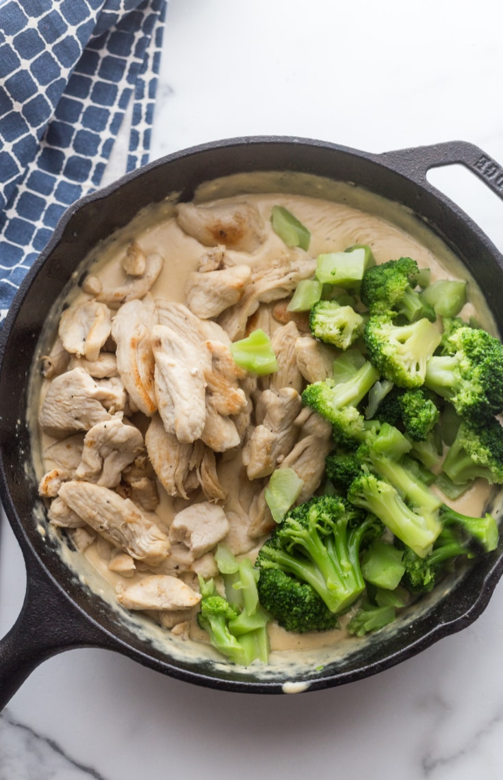 chicken, broccoli, and Alfredo sauce in the skillet