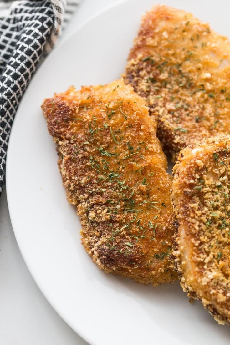 fried keto pork chops on a white plate