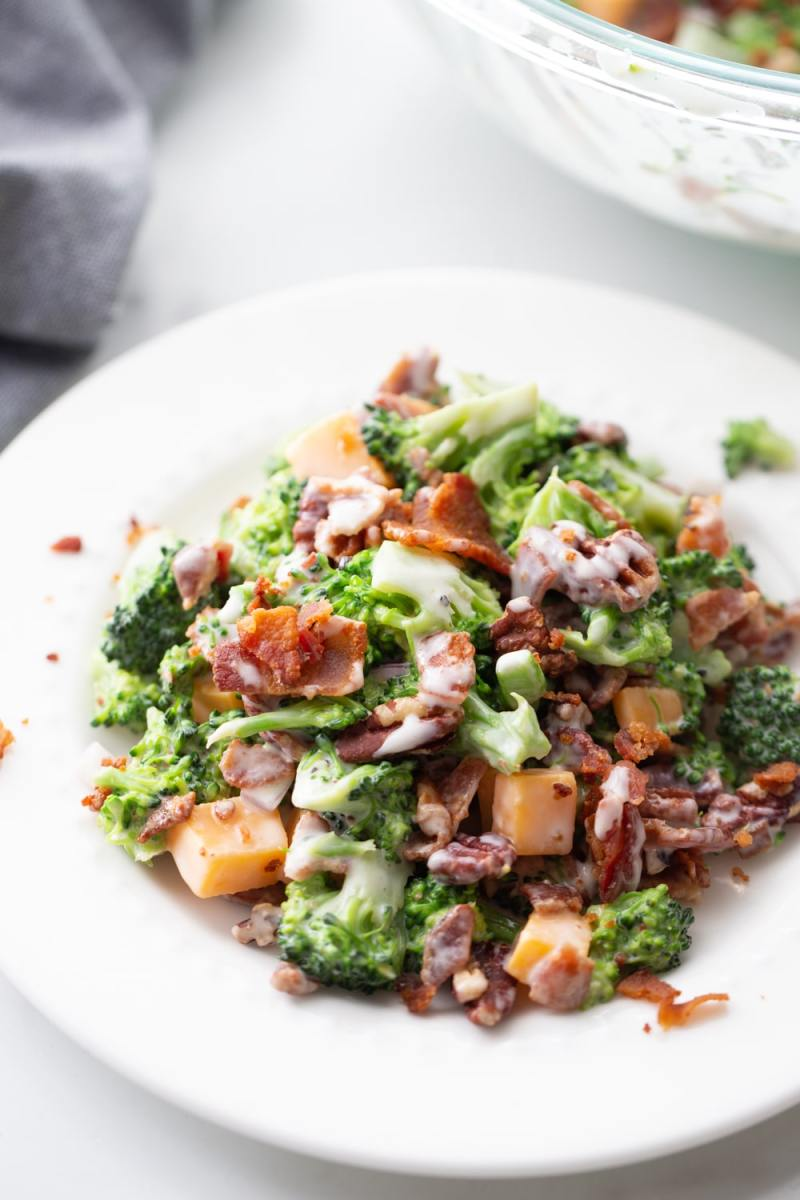 low carb broccoli bacon cheese onion salad on a white bowl