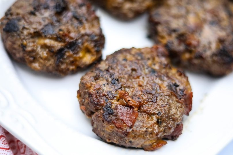 grilled burger patties on white plate