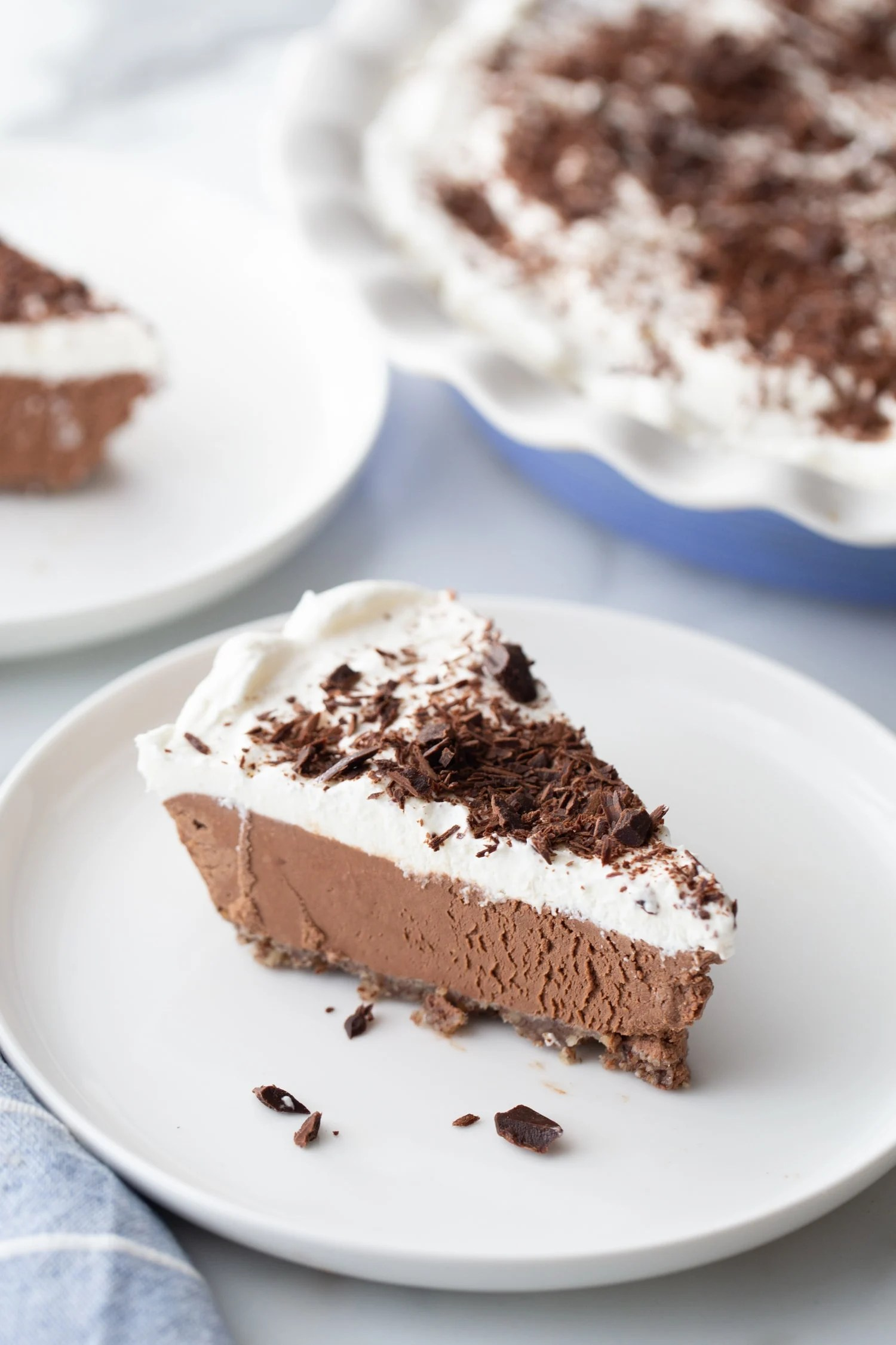 slice of keto chocolate mousse pie on a white plate