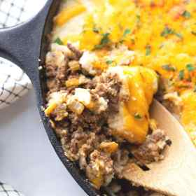 shepherds pie with ground beef and cheese in a skillet