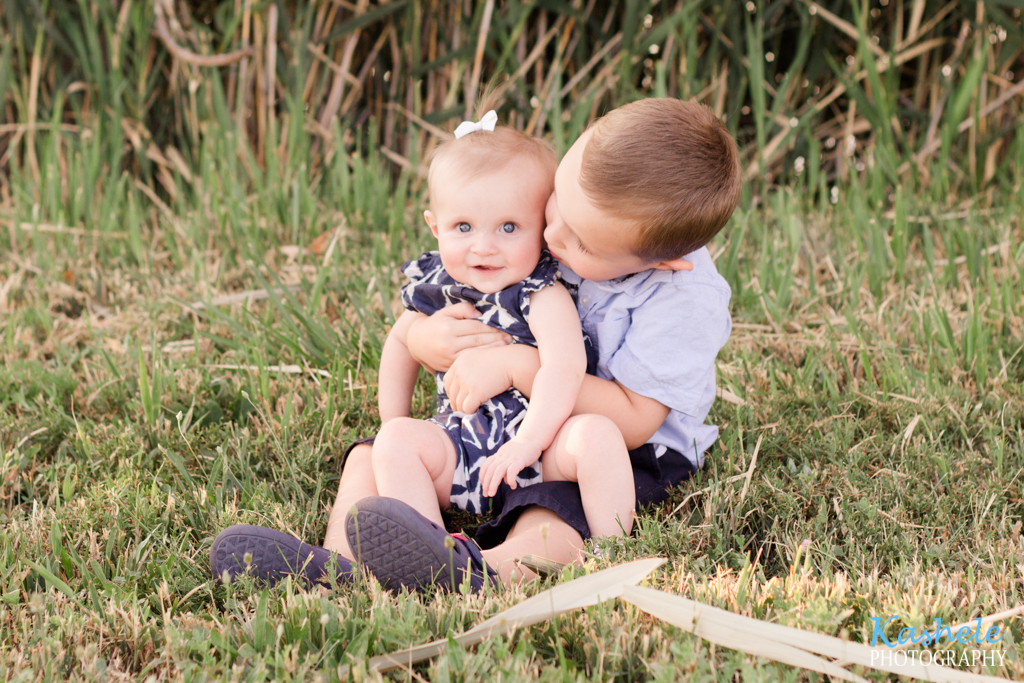 Image of the Hardy Family little boy kissing his sister