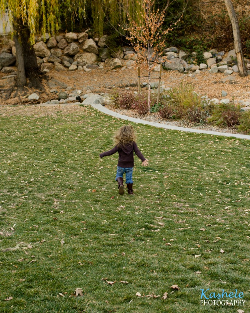 2019 Fall Family Session Little girl running down the hill