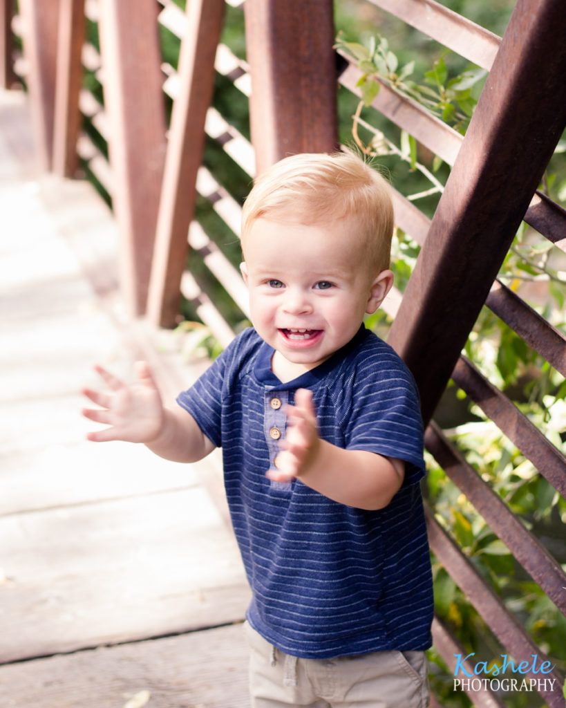 Utah County Milestone Photography session image of baby smith clapping