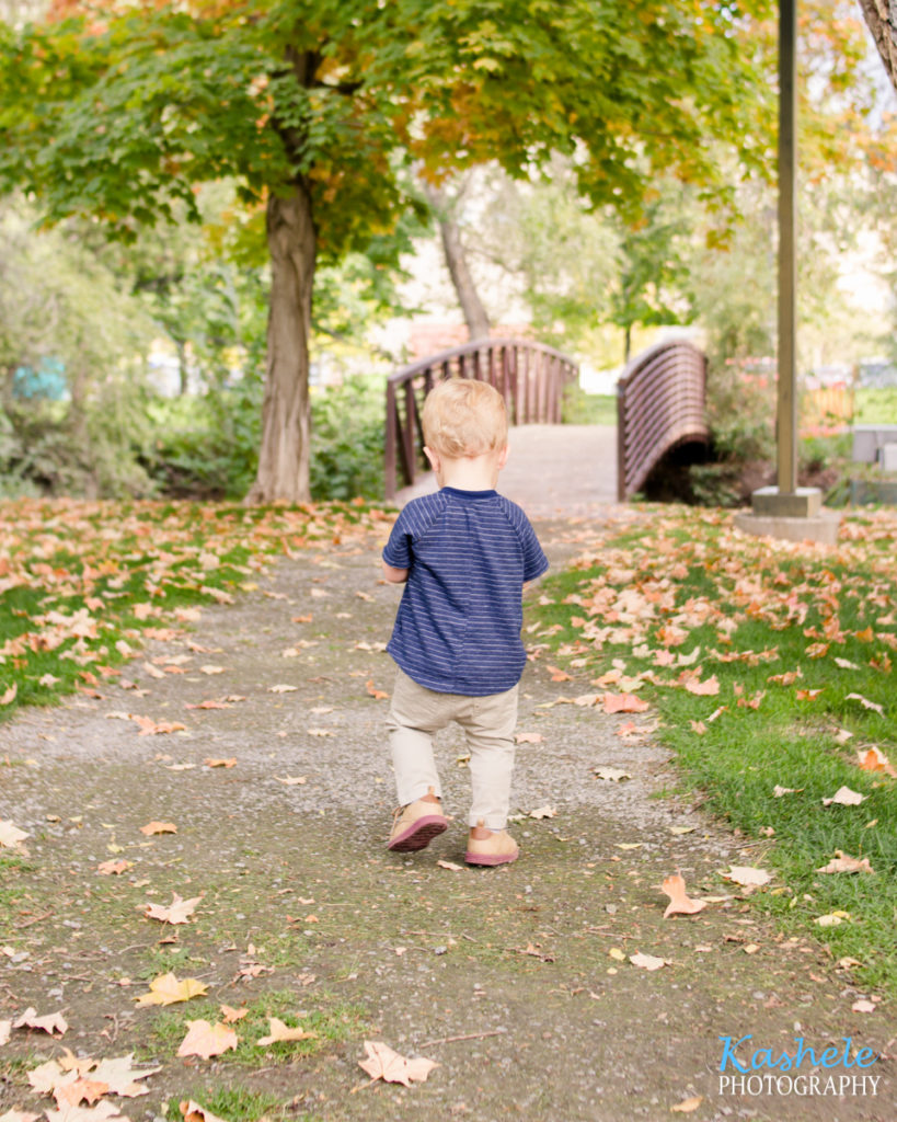Image of little man smith walking toward a bridge
