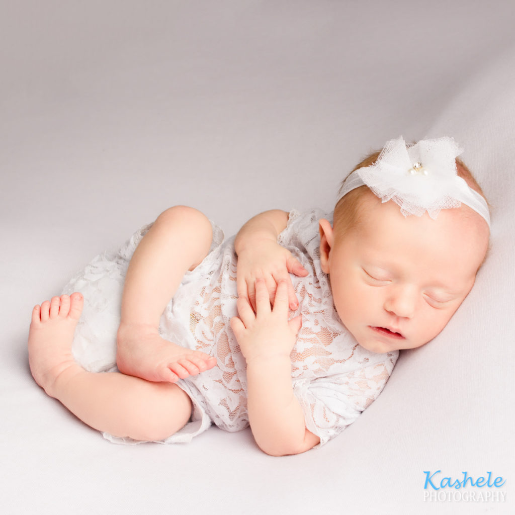 Baby in back pose for utah newborn photographer post