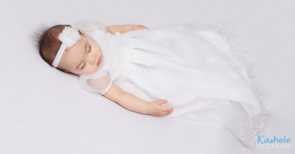 baby dream session image baby girl sleeping on her back