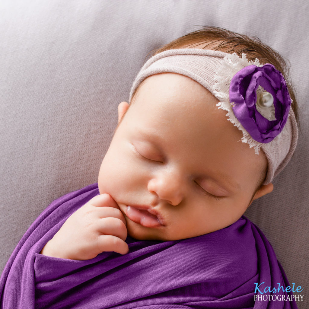 Image of baby girl in a thoughtful pose