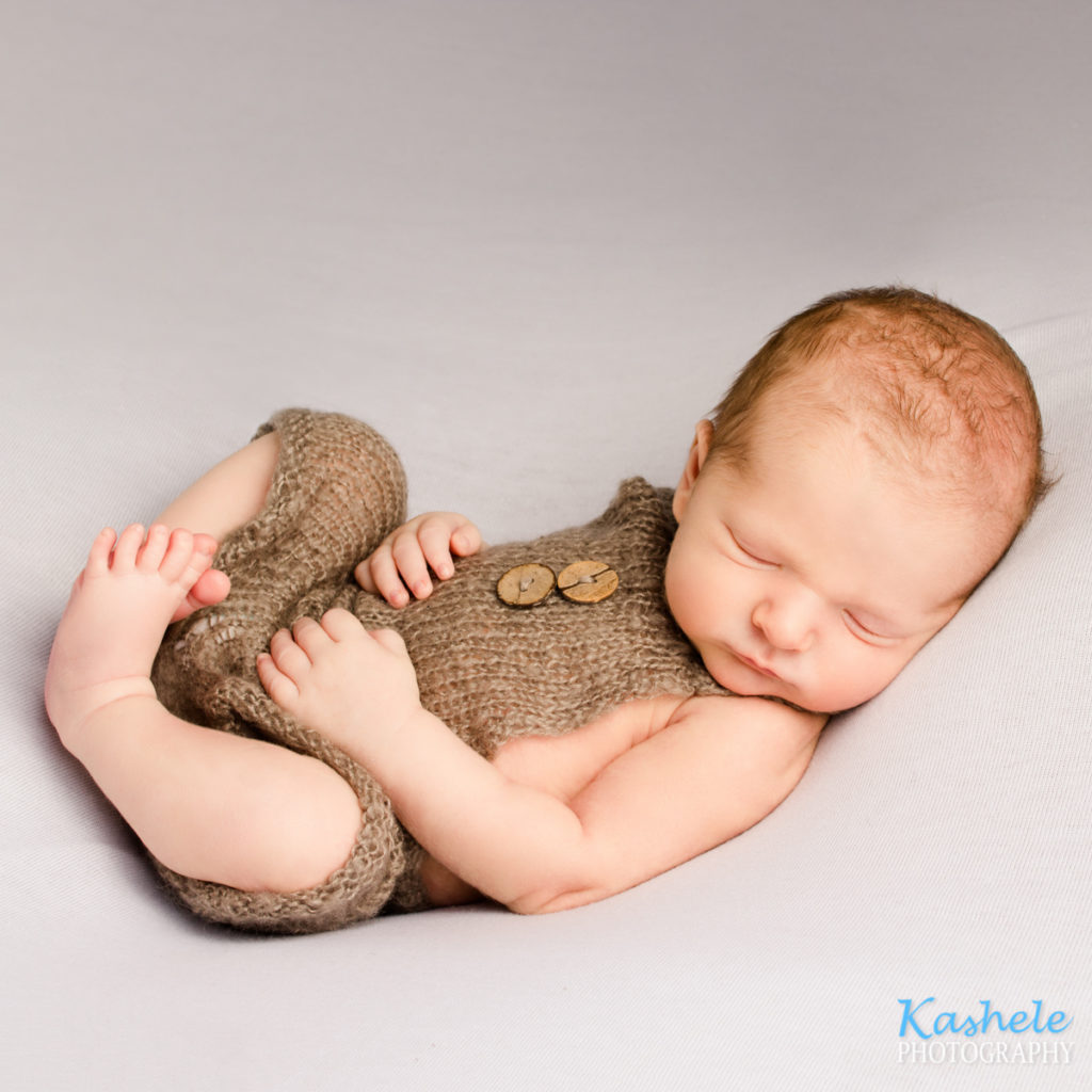 Utah newborn photography baby in huck finn pose
